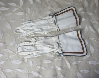 1920s Ivory Kid Leather Gauntlet Gloves with Saucy Details....size 7...    Made in France for Bonwit Teller