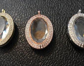 Beautiful facet glass memory charm locket.