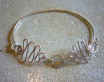 Silver Ribbon Bracelet SquareHare Celtic jewellery Free Postage Vegan UK