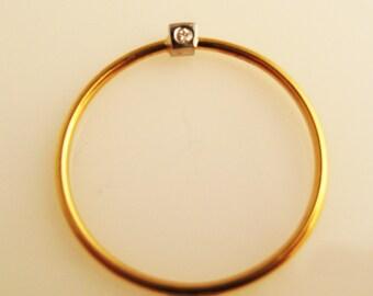 Jive, a Diamond, Platinum and 22K Gold Ring