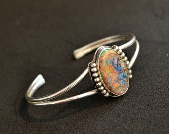 Sterling Opal cuff bracelet .  Fits up to 7 inch wrist.