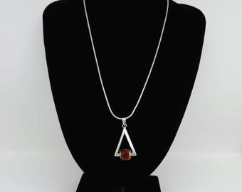 Super Stylish Seventies Silver and Caramel Amber Pendant.