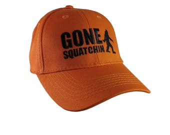 Gone Squatchin Black Sasquatch Bigfoot Humorous Embroidery Design on an Orange Adjustable Structured Baseball Cap for Kids Age 6 to 14