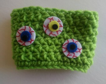Crocheted Cup Cozy with Felt Eyeball Appliques