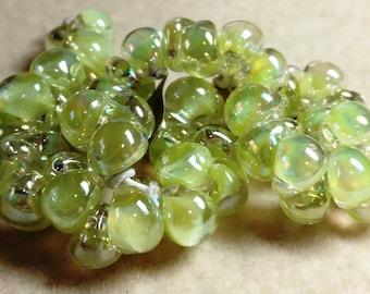 Unicorne Teardrop, Boro Glass, Color: 22258, Stardust Luster, Strand of 25 beads