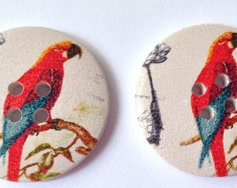 Buttons printed with a red parrot