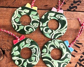 Four Ceramic Wreath Ornaments