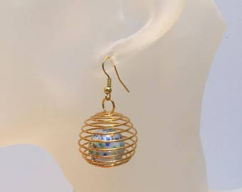Gilded cage multicolored bead earrings