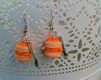 Peach colored button earrings