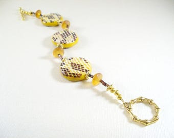 Conda bracelet, yellow and brown snake print