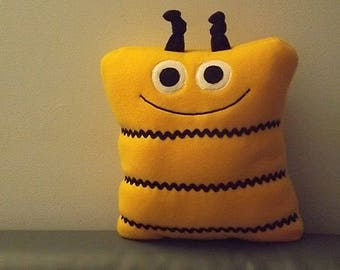 Bee plush pillow pet in bright yellow fleece with black trim