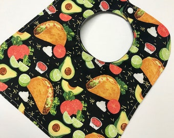 Taco party baby bib colorful tacos, avocados, salsa, lime, sour cream dip and grey and black plaid flannel back plastic snaps reversible