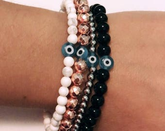 Your choice of Classic Evil Eye Bracelets White Howlite• •Rose Gold Hematite• •Stainless Steel Silver••Black Onyx