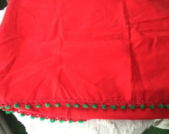 Red rectangular Christmas tablecloth with green trim