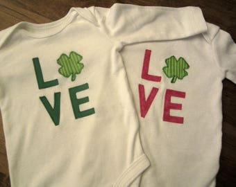 St. Patrick's Day Appliqued Pink or Green Love with Shamrock Clover on White long or short-sleeved Onesie, sizes 3 months - 24 months.
