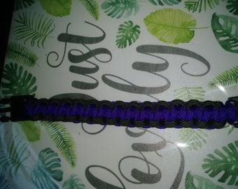"""Purple and black """"Cobra Style"""" paracord survival bracelet."""