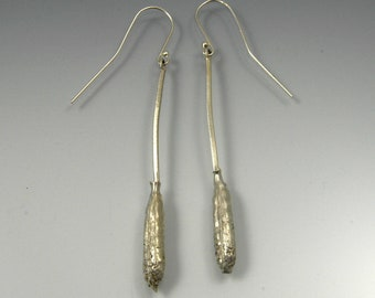 Sterling silver dangle earrings with arugula seed pod cast from nature on a hammered silver wire