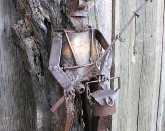 Tall Fisherman Metal Sculpture On Black Oak Board