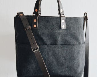 Shoulder Sling tote bag with adjustable leather strap & drop-down handles. Alaskan belt Leather Handles. Cotton Canvas .Made in Singapore