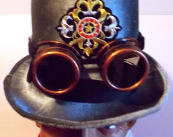 """Pick of 5, Steampunk felt Top hat in gray,6"""" tall,fabric liner,black hat band, goggles,size 7.11""""brim to brim,patch of choice, unique gray"""