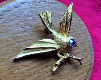 Bird on a branch gold tone with blue rhinestone eye