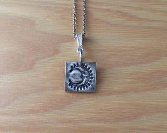 Tiny crescent moon pendant in fine silver