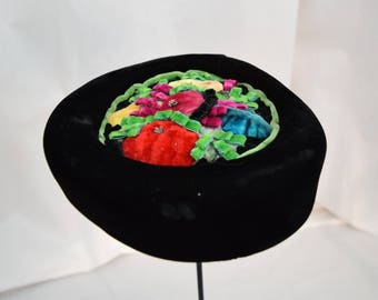 Vintage 1950s 1960s black velvet pillbox hat with multi color velvet floral crown netting union made