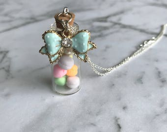 Pastel macaron  in a bottle necklace. Polymer clay charms handmade food miniature jewellery. Glass bottle