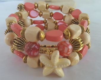 3 Coil Coral and Cream bracelet
