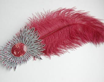 hat feather brooch with garnet feather