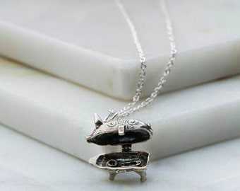 Vintage inspired sterling silver piggy bank charm necklace which opens to reveal a miniature safety pin and button