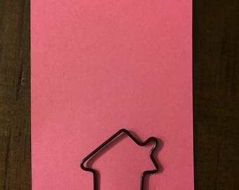 Black house paper clip