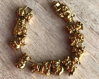 """Vintage bracelet """"Jolly Pigs"""". Bracelet on a double chain with charms. A gift for her. Jewelery alloy."""