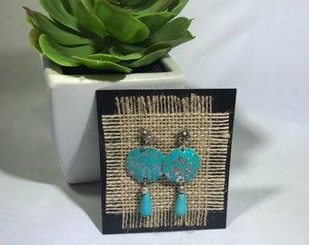 Beautiful embossed metal earrings in turquoise and silver