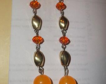 Long orange dangle earrings