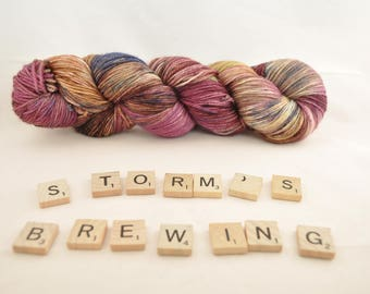 "Hand-dyed yarn, ""Storm's Brewing"" variegated, soft and squishy yarn. Great for socks or shawls. 80/20/ Superwash wool/Nylon"
