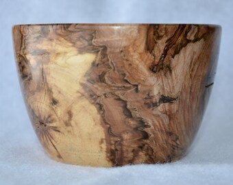 Strikingly distressed grain wooden bowl