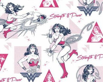 Wonder Woman Strength and Power Magenta by Camelot Fabrics