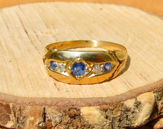 Antique 18K yellow gold 'old mine cut' diamond and sapphire ring.