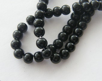 55 Black glass beads B23