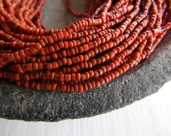 MINI orange red glass seed beads, rustic  opaque delicate spacer  tube barre, irregular shape Indonesian - 1 to 2mm (44 inches std) 7ab31-3