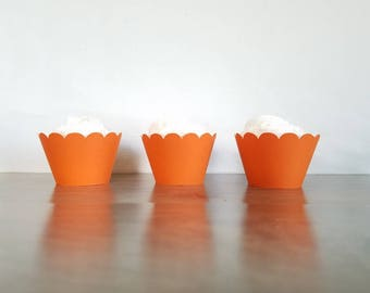 12 Count orange scallop cupcake wrappers!