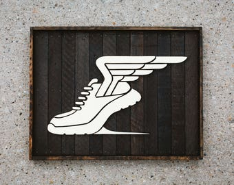 handcrafted running shoe on reclaimed wood