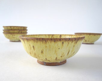 Five Small Yellow Speckled Pottery Bowls