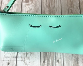 Soft Faux Leather Pleather Makeup, Pencil, Pen, or travel bag Teal with Lashes Je t'aime and message on the back: Ciao Bella!