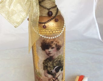 Decorated upcycled wine bottle