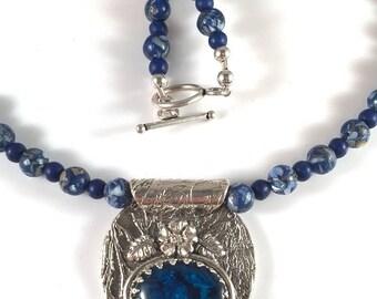 Silver Pendant with Blue Paua Abalone Cabochon