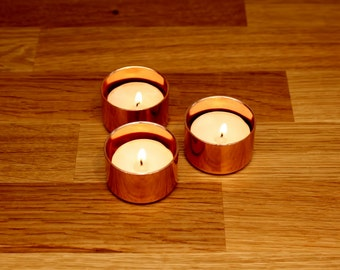 Set of three copper tealight candle holders