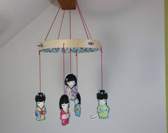 Small round mobile of Japanese dolls.