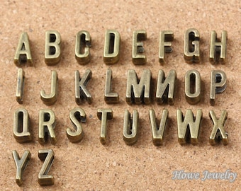 a set of 26pc 11mm antiqued bronze slide alphebet letters charms findings